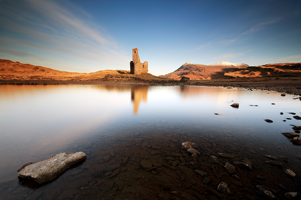 A motorhome holiday means you can take the time to savour beautiful views like this… the sunrise over Loch Assynt and the ruins of Ardvreck Castle.
