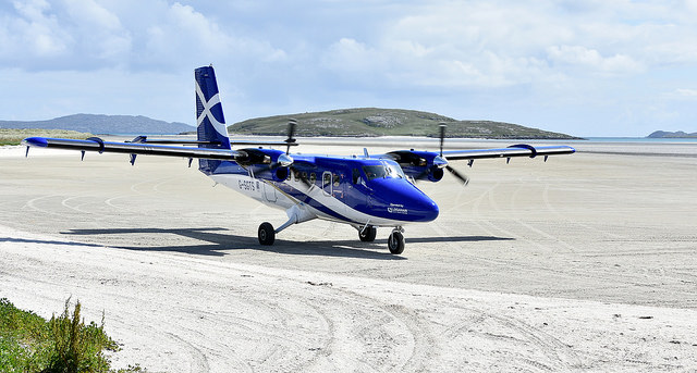 A plane on the sandy airstrip at Barra airport. Photo credit: James Stringer