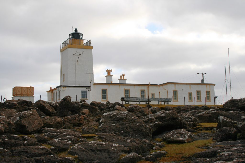 Eshaness lighthouse (now privately owned) in the Shetland Islands, beside stunning cliffs.