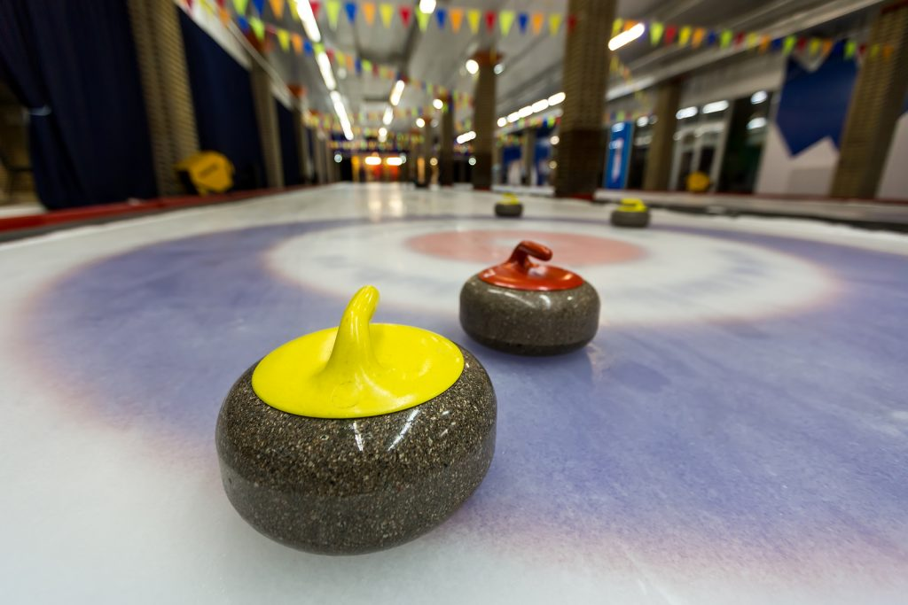 Curling stone on ice of a indoors rink