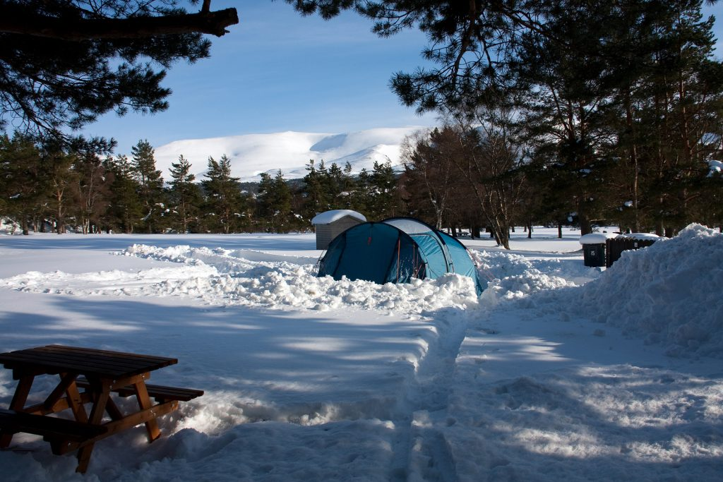 Camping in the Cairngorm Mountains, Scotland, over Loch Morloch with snow on the ground