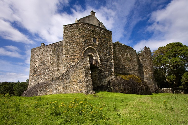 Dunstaffnage Castle on the north west coast of Scotland near Oban in Argyll and Bute. This monolithic and impregnable-looking fortresss was constructed in the 13th century and has historic connections to Robert Bruce and Flora Macdonald.