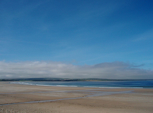 Backed by rolling sand dunes, Dunnet Bay stretches out for over 2 miles, and is a lovely sheltered spot for paddling and other beach activities. Photo credit: Adrienne Reid